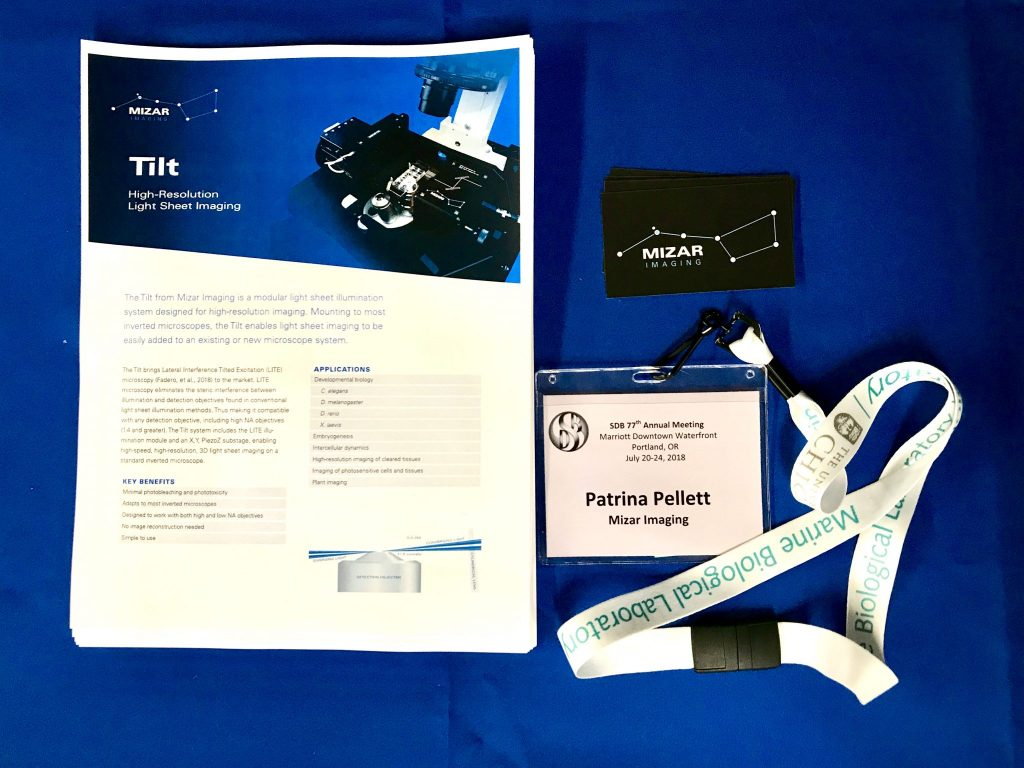 The Tilt Light Sheet Module Datasheet, business cards and Patrina's name badge from SDB 2018 table.